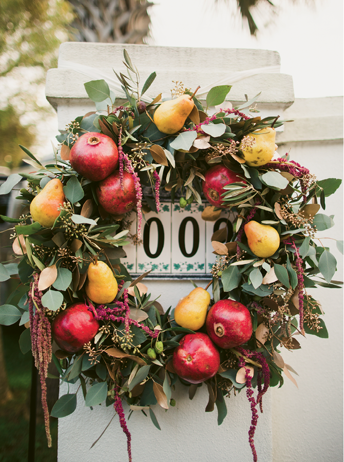 Branch Design Studio integrated pomegranates and pears into harvest-style wreaths.  (Image by Juliet Elizabeth Photography)