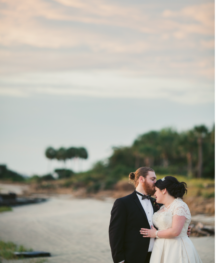 """Victoria chose their Halloween wedding date not for the holiday, but for its proximity to the month's full moon. """"The tide pulls back enough to give you a tiny private beach [at my parents' house], which makes for great photos,"""" she says.  (Image by Juliet Elizabeth Photography)"""