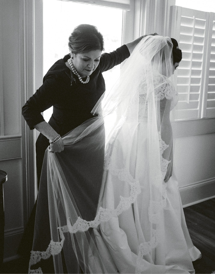 Dottie helps Victoria with her veil as the bride got ready for her ceremony at Stella Maris. Image by Juliet Elizabeth