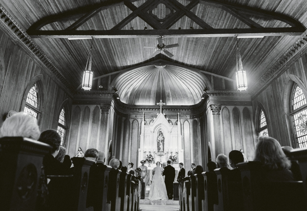 """""""Getting married at the church where my  grandfather laid the cornerstone really spoke to our day's strong sense of place,"""" says the bride of the ceremony at Stella Maris on Sullivan's Island.  (Image by Juliet Elizabeth Photography)"""