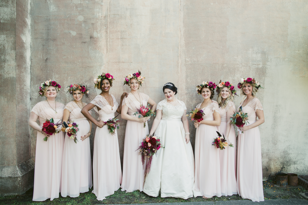 Ground-skimming pale pink dresses and golden lockets enhanced the maids' ethereal look. (Image by Juliet Elizabeth Photography)