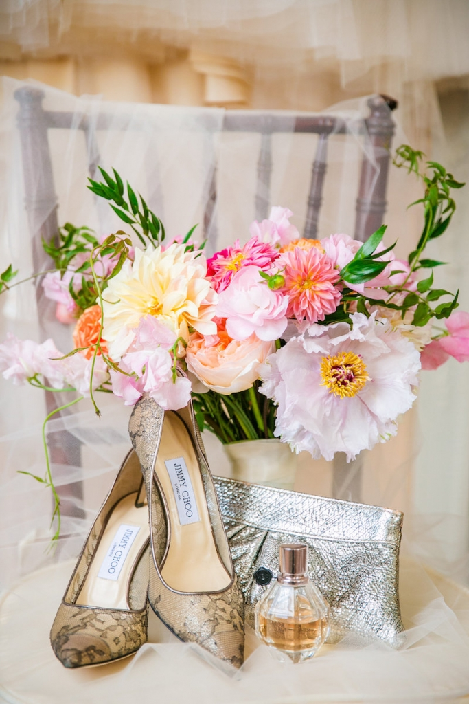 Florals by Branch Design Studio. Bride's shoes by Jimmy Choo. Image by Dana Cubbage Weddings.