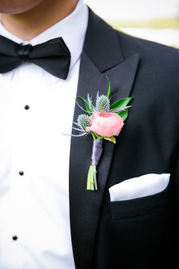 Groom's attire by Hugo Boss. Boutonnière by Branch Design Studio. Image by Dana Cubbage Weddings.