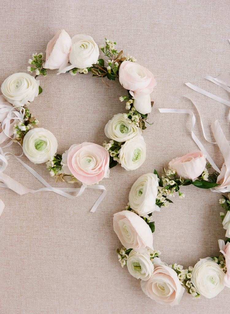 Flower girls donned sweet crowns of cream and pale pink ranunculus. <i>Image by Lucy Cuneo Photography</i>
