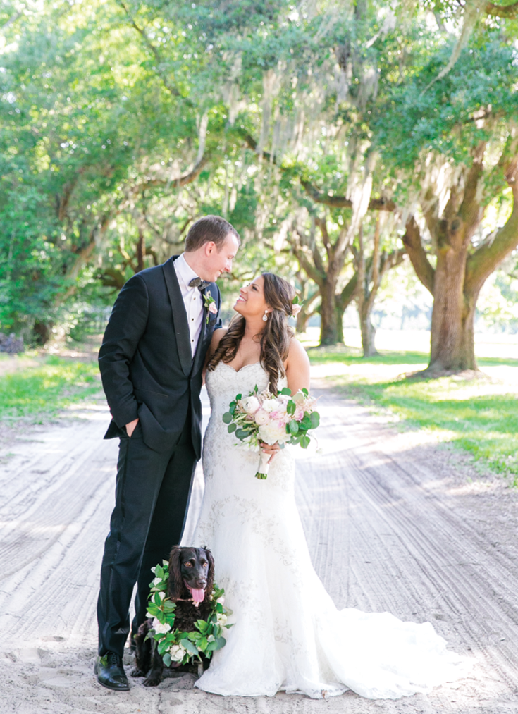 Although dogs, including the couple's beloved  Boykin Spaniel, Millie, aren't allowed in The Citadel's Summerall Chapel (where Lea and Cooper exchanged vows), the pup popped in for portraits before joining everyone at the reception.    <i>Photograph Dana Cubbage Weddings</i>