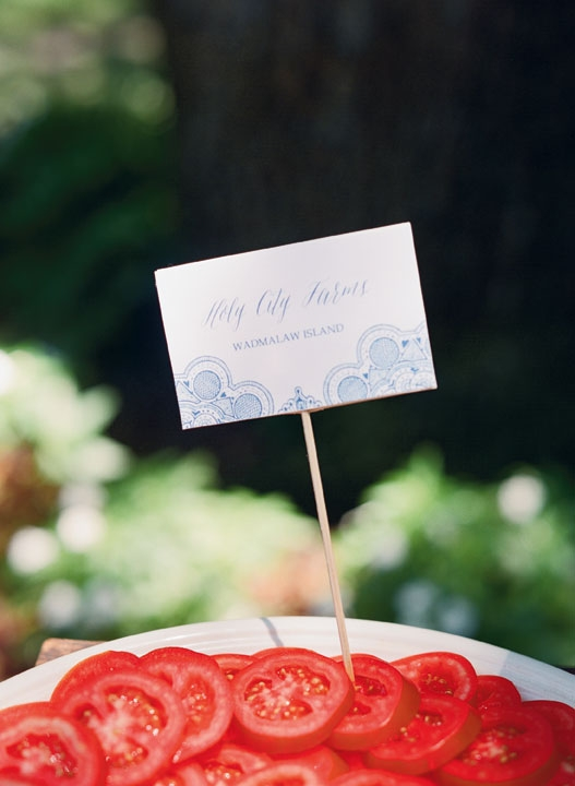 To celebrate summer flavors during the post-ceremony cocktail hour, Cru Catering set up an heirloom tomato tasting bar outside with house-smoked mozzarella and fresh basil. Tags (with my niece's invitation motif) noted the varieties and farms.