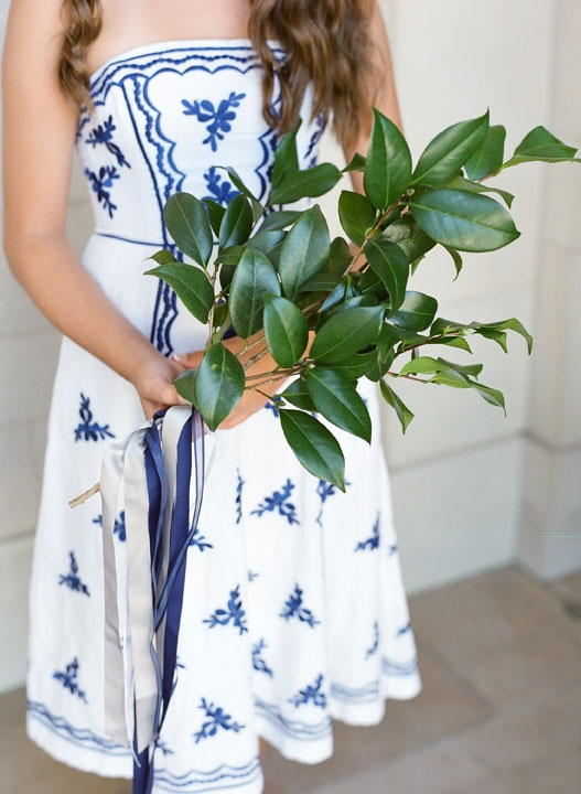 Flower girls (in pick-your-own blue-and-white dresses, like the bridesmaids) held camellia boughs. Bridesmaids walked arm-in-arm with groomsmen. The point of both? We got to skip pricier bouquets all around.