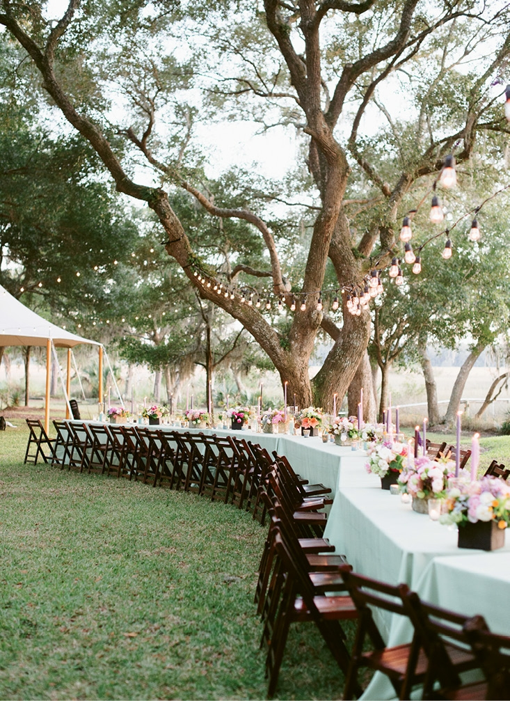 Design-wise, says  Marianne, Teil gravitated toward warm and whimsical touches, which the winding dinner table delivered in spades. Nearby, a canvas tent housed the band.  (Image by Natalie Franke Photography)