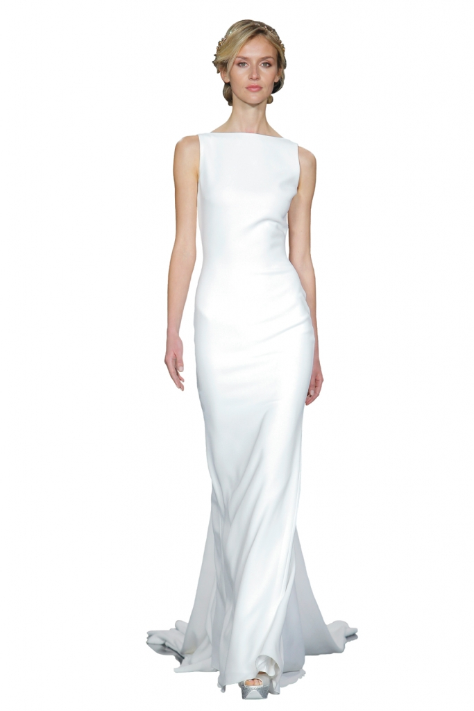 """TREND: Bateau neckline (Surprise! The back of this gown is bare with a stunner of a train.) GOWN: Pronovias' """"Nogal,"""" available in Charleston through Gown Boutique of Charleston"""