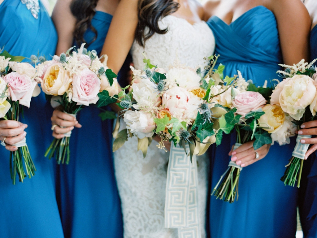 Bride's gown by Anne Barge, available in Charleston through White on Daniel Island. Bridesmaid gowns by Alfred Angelo, available in Charleston through Bridals by Jodi. Florals by A Charleston Bride. Image by Ryan Ray Photography.