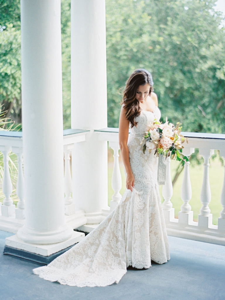 Bride's gown by Anne Barge, available in Charleston through White on Daniel Island. Hair and makeup by Ash and Co. Dress steaming by Cacky's Bride + Aid. Image by Ryan Ray Photography at Lowndes Grove Plantation.