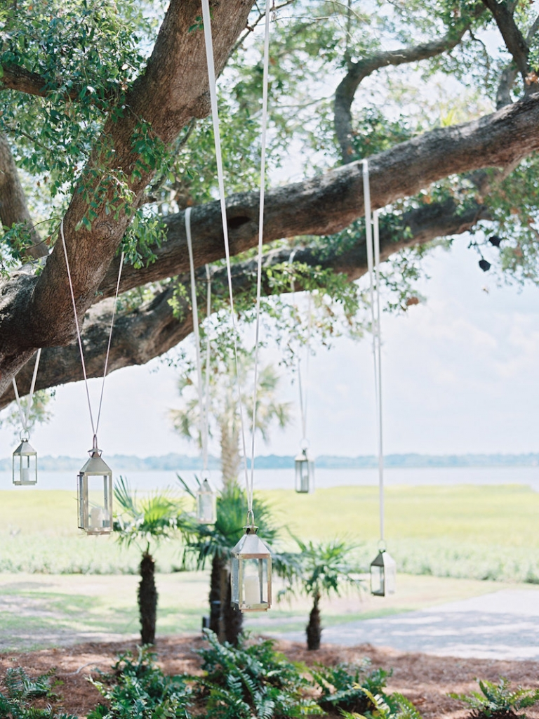 Wedding design by A Charleston Bride. Lighting by Technical Event Company. Image by Ryan Ray Photography at Lowndes Grove Plantation.