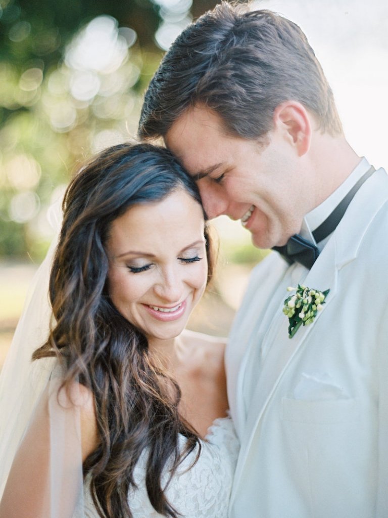 Hair and makeup by Ash and Co. Boutonnière by A Charleston Bride. Image by Ryan Ray Photography at Lowndes Grove Plantation.