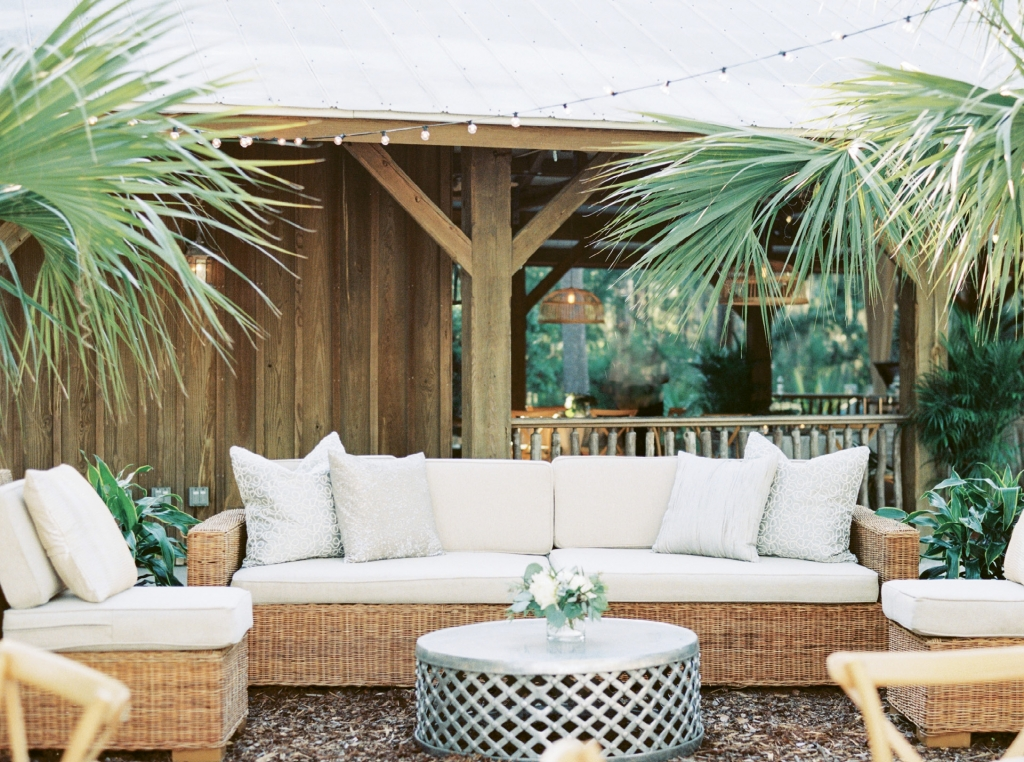 Shimmering elements—pillows, tables, linens—played off the gray and white tabby of the site and its tin-roof shelter.
