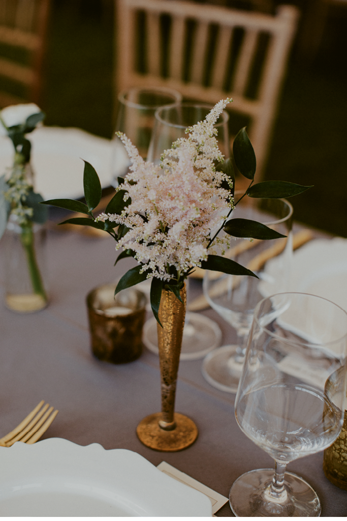 Brass Tacks - For a plated dinner with full settings, slender arrangements (like this astilbe posy) add beauty without overcrowding the tabletop.