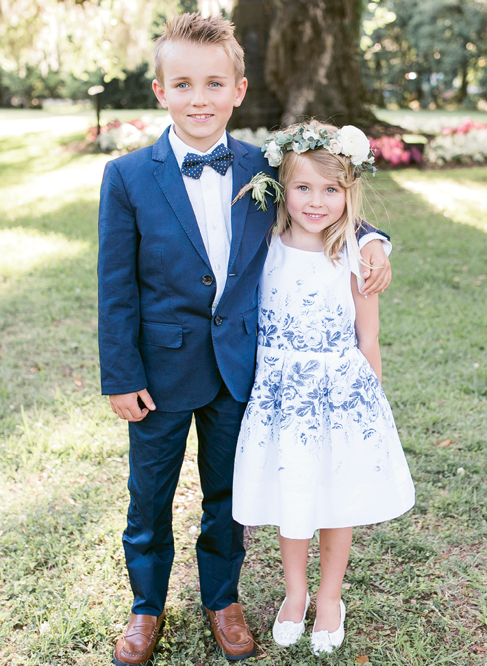 """First cousins to the bride (and offspring of one of her bridesmaids), Blake and Taelen served as junior usher and flower girl in the Souders-Colao wedding. """"Taelen,"""" says Brittney, """"set the stage for me to walk down the aisle by passing out petals individually to guests."""" Image by Jenna Marie Weddings"""