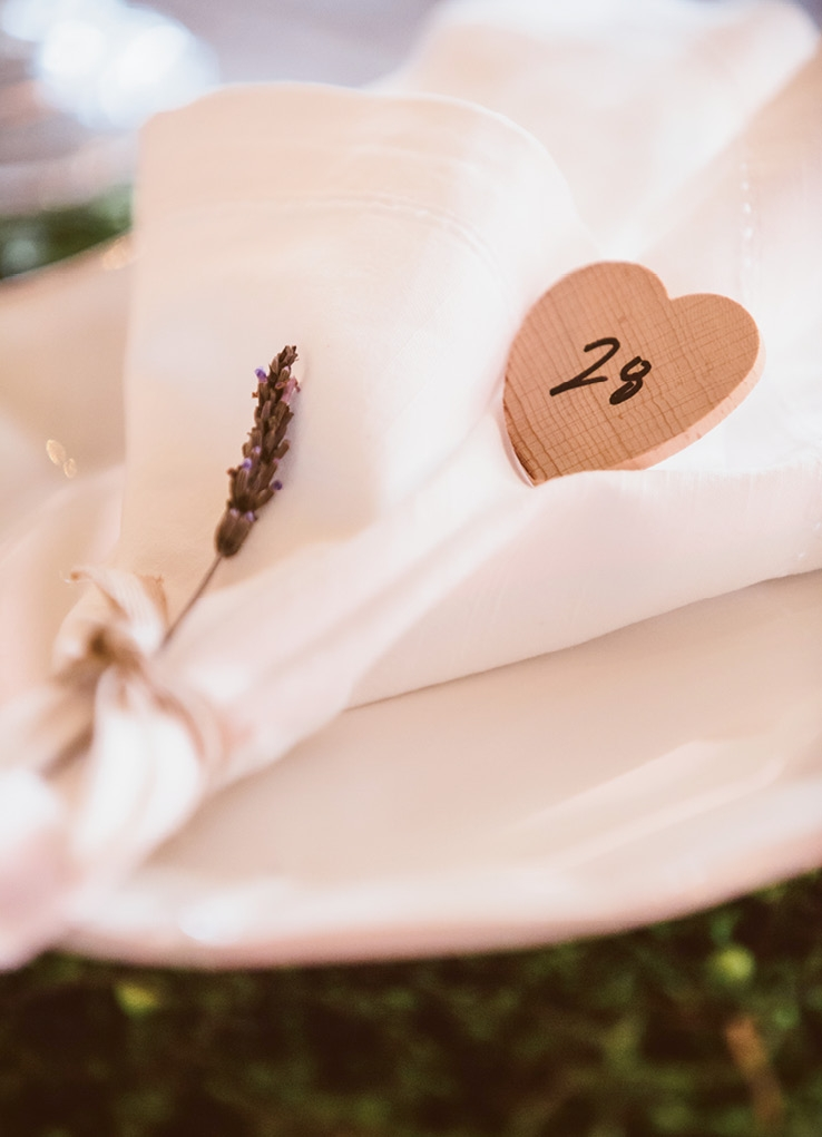 A lavender sprig and heart-shaped placeholder added romance to table settings.   <i>Amelia + Dan Photography</i>