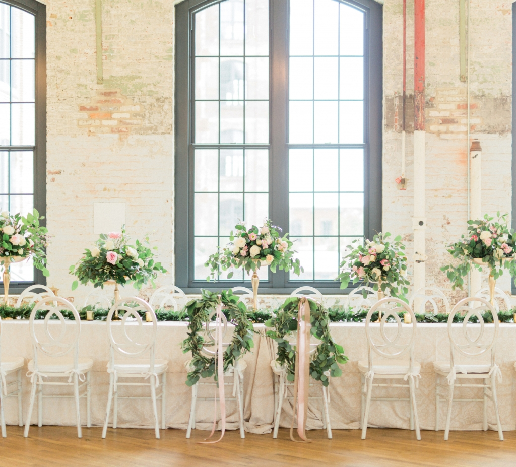 To soften The Cedar Room's industrial aesthetic, Pure  Luxe Bride filled the space with verdant eucalyptus leaves, pillowy blooms, gilded vessels, and light, bright furnishings.   <i>Image by Catherine Ann Photography</i>
