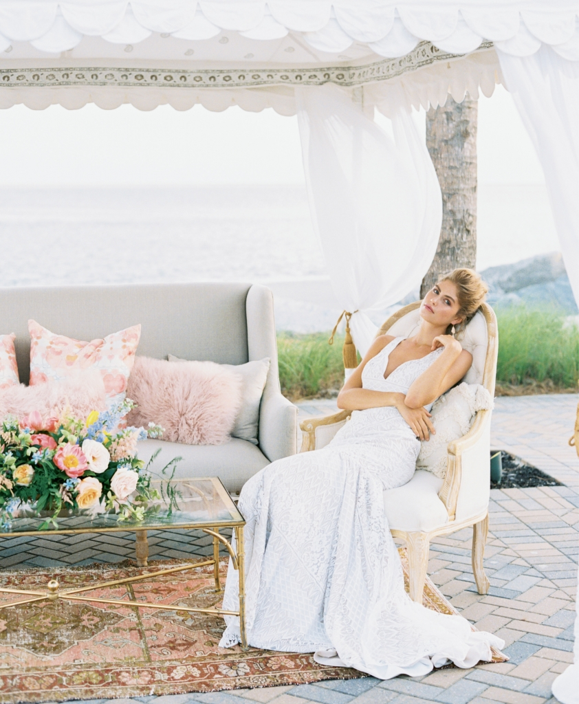 """""""Mariposa"""" gown from Kate McDonald Bridal. Kendra Scott earrings from Bella Bridesmaids. Tent and lounge from Out of Hand. Florals by Out of the Garden. Location: Seabrook Island Club, Ocean Terrace. Note: Sea Island residents, club members, and off-island couples can rent the Seabrook Island Club Ocean Terrace for ceremonies. Photograph by Perry Vaile"""