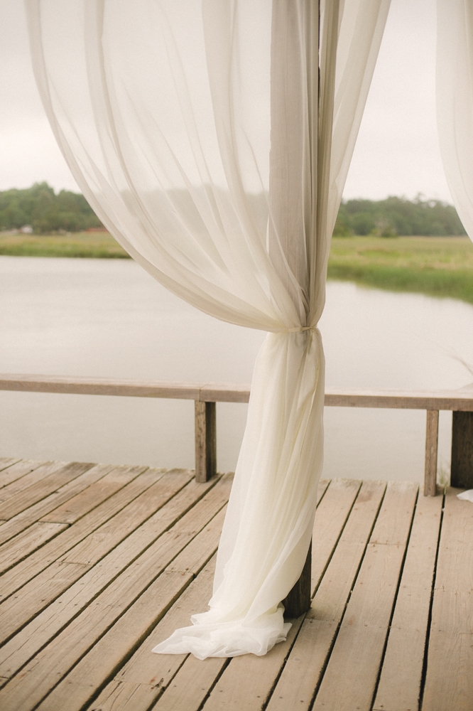 Light Touch - Soften unfinished  docks and decks  with gossamer  draping.    <i>Image by Evan Laettner Photography</i>