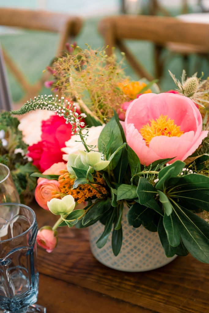 """Patterned vessels held colorful combinations of garden roses, hellebores, lysimachia, orchids, peonies, and ranunculus. Says florist Anne Bowen of Charleston Stems: """"Late spring brings so many options—the sky's the limit!"""" <i>Image by Timwill Photography</i>"""