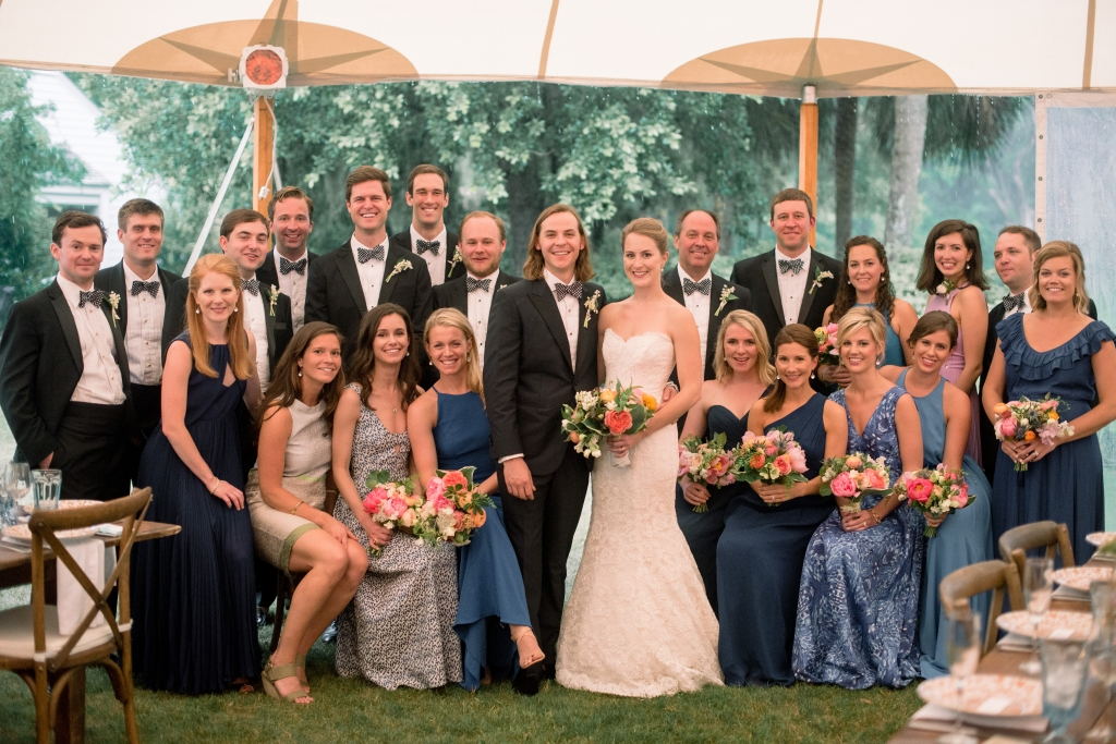 """Jane trusted her bridesmaids to select their own blue-hued frocks.  """"I love that two of them chose patterns,"""" she says. """"It added depth and fit the theme."""" <i>Image by Timwill Photography</i>"""