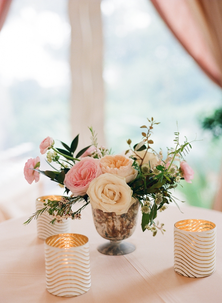 Mixed metallic vessels gave a warm touch to tabletops. <i>Image by Lucy Cuneo Photography</i>