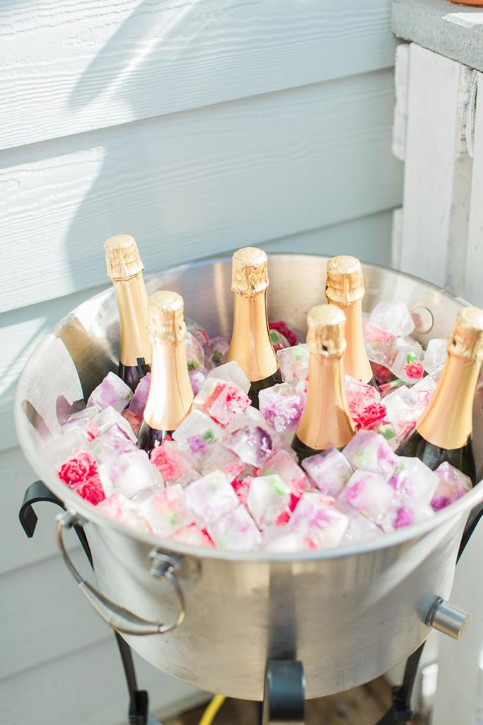 For bride Katie Berry's flower-crown party, hostess Andrea Krause put the champs on ice with a little thematic flair. Freeze edible flowers in ice trays two days in advance and voilà! Your ice chest becomes a décor element.
