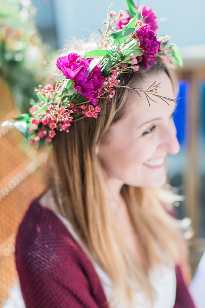The bride wearing her flower crown.