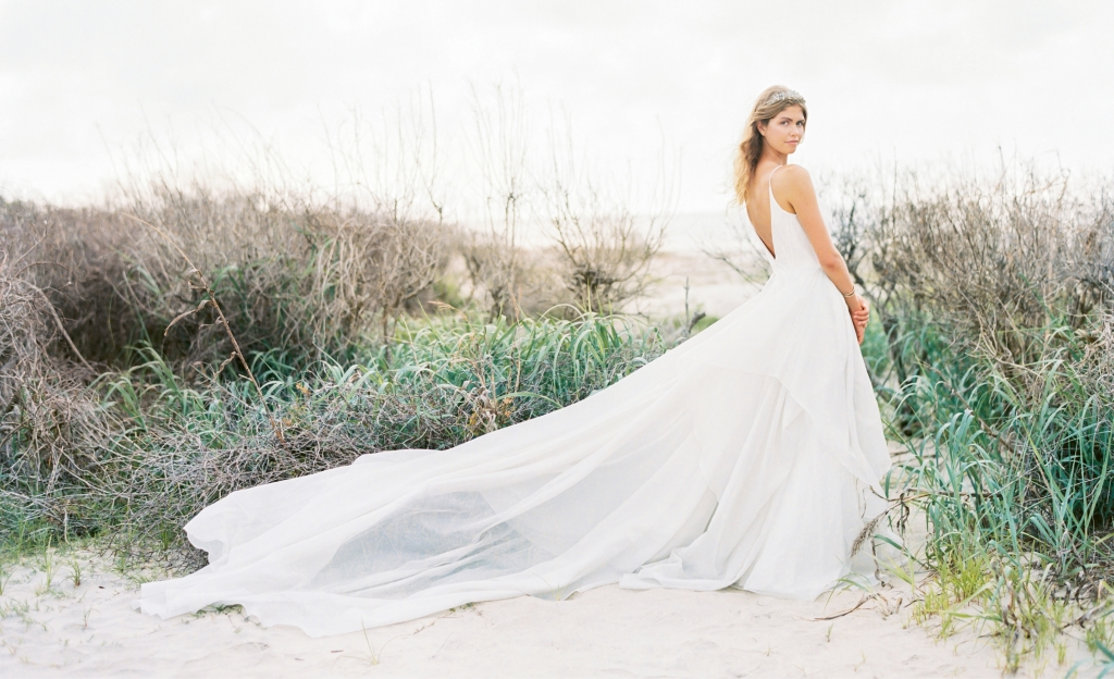 """Carol Hannah's """"Lutosa"""" metallic silver gown from Southern Protocol Bridal. """"Andes"""" smoky quartz crown by Emma Katzka. Hammered cuff from Out of Hand. Location: Seabrook Island, Beach Access 6. Photograph by Perry Vaile"""