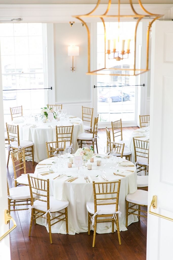 TIP: Work with your venue's existing décor. Indoor brass lanterns and chandeliers and antique gilded mirrors pop up throughout The Gadsden House. Hone in on the underlying metallic in your venue's lighting, hardware, and décor to coordinate your rentals and more.  Image by Dana Cubbage Weddings