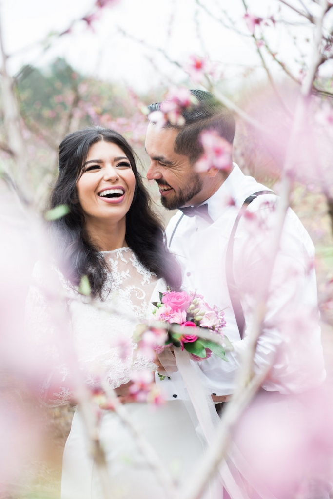 Last March—11 years after they wed—Marilu and Cesar Segura held a do-over portrait session in Charleston. Boone Hall Plantation (where peach blossoms were in full bloom) hosted some of the stunning shots. <i>Image by Judy Nunez Photography</i>