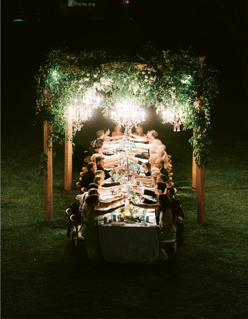 One hundred and sixty guests from the States, Germany, Canada, France, and England toasted the couple underneath a host of custom-made arbors.