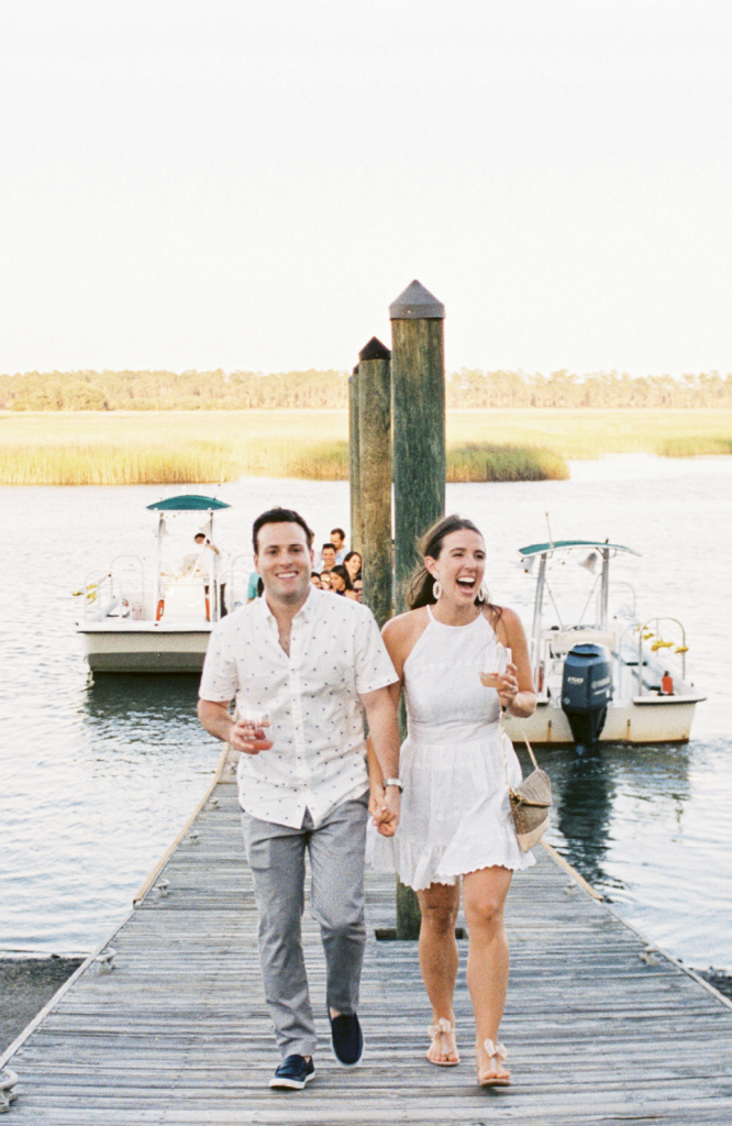After the ceremony rehearsal, the couple joined their wedding party for dockside cocktails, then boated to the welcome party site. As everyone disembarked, they were announced to the rest of the guests.
