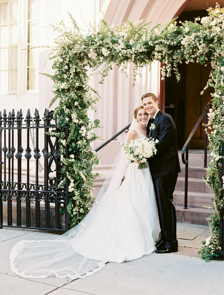 Gathering Events covered the French Huguenot Church's wrought iron entry in sweet peas, stock, roses, and more.