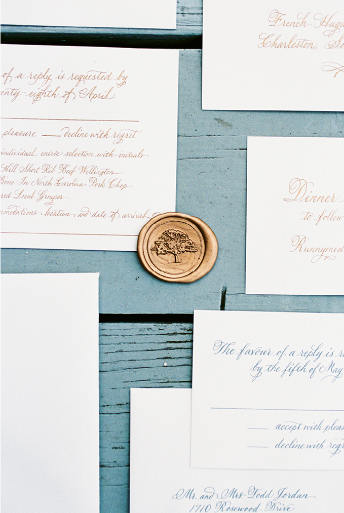 The stationery suite's wax seal and embossed oak tree not only represents a Lowcountry icon, but also a favorite tree that shaded a bench where the couple often took in the sunset during their dating years.